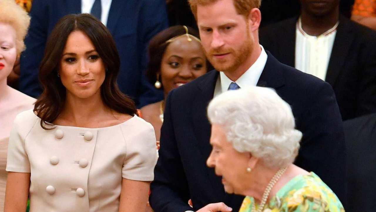Royal Family: Meghan Markle e Harry Winsor osservano la regina Elisabetta II (foto Getty Images).